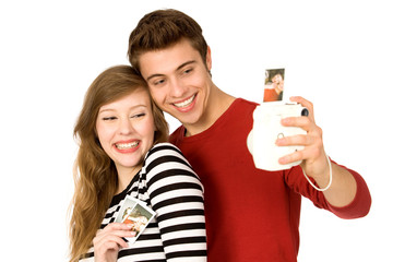 Young couple with instant camera