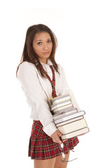 school girl with books serious