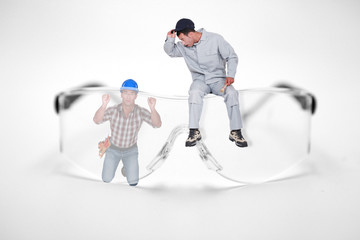 Photomontage of workers with giant goggles