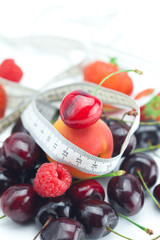measure tape,strawberry, apricot, cherry and raspberry isolated