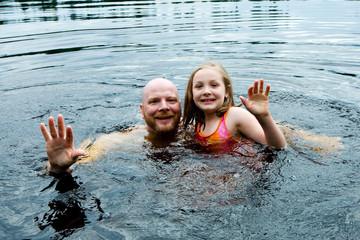 Family fun swimming in a lake
