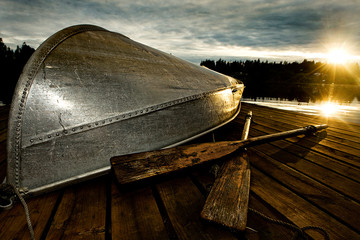 row boat at sunset on a dock