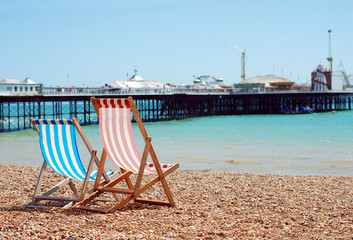 deck chairs on the beach Brigton England