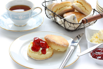scone with strawberry jam and clotted cream , cream tea