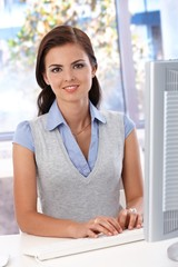 Beautiful woman working at desk smiling