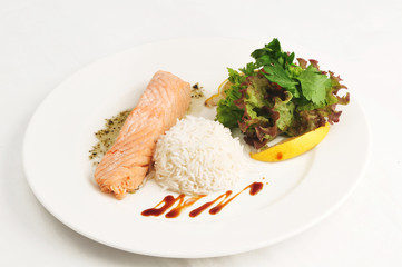 Boiled salmon with rice and salad