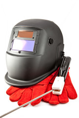 Protective welder mask, electrode and gloves on white background