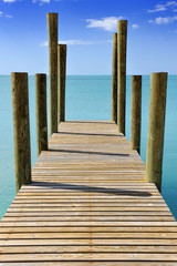 Wooden jetty leading into a turquoise sea in Governor's Harbour