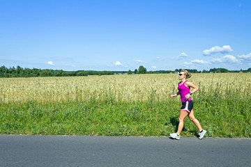 Running woman on summer country road