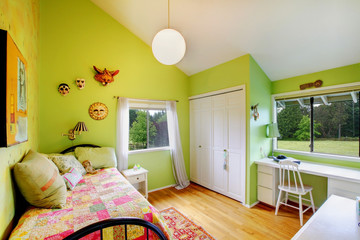 Green kids, girls bedroom.with white furniture.