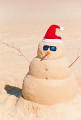 Wall Mural - Snowman Built As Sandcastle On Beach