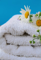 white towel with daisies on a wooden table