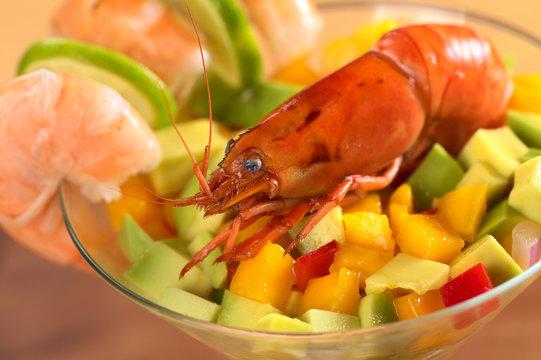 Fresh cooked shrimp on avocado/mango salad