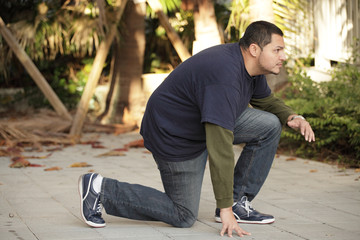 Man in a crouching pose