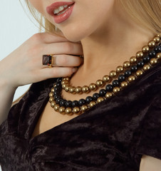 beautiful woman wearing pearl beads and ring