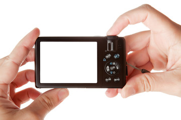 Hands holding digital photo camera, copy space for your image