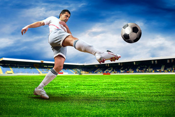 Photo sur Toile Le football Happiness football player after goal on the field of stadium wit