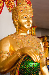 Golden god statue at the temple