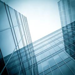 black texture of modern glass business center in haze