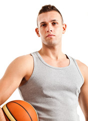 Muscle man holding a basketball