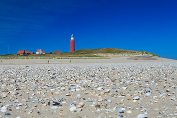 Seaside with sand dunes and  lighthouse Wall mural