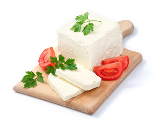 White Bulgarian cheese, arranged with tomatoes and parsley on cu