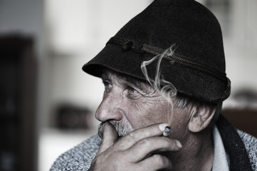 Closeup Artistic Photo of Aged Man With  Grey Mustache Smoking