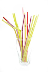 plastic drinking straws in glass