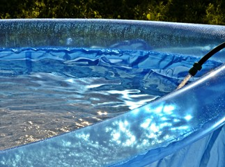 Blue inflatable swimming pool