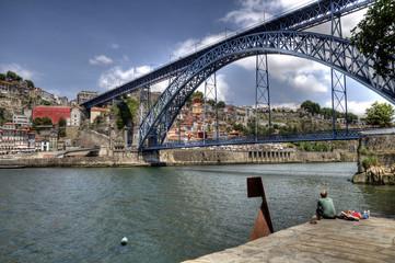 Tourists by The Dom Luís I Bridge, Porto, Portugal