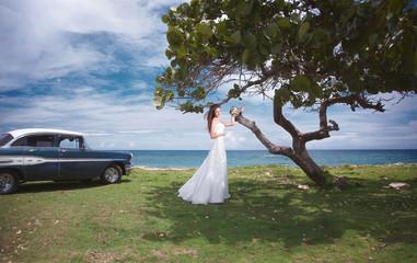 Beautiful wedding day. Pretty bride on the carribean beach