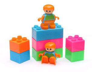 Colorful building blocks with two plastic babies