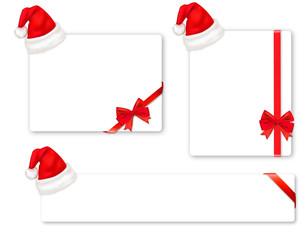 Red boww with ribbons and Santa hats. Vector.