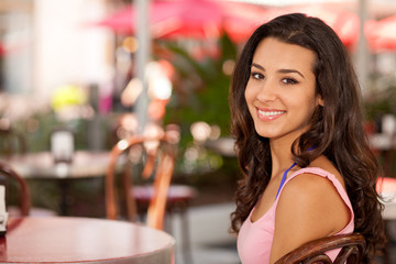 Pretty Girl in an Outdoor Cafe