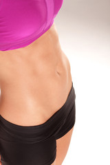 Close up portrait of perfect female muscular stomach
