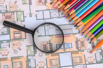 House plan,magnifier and color pencils