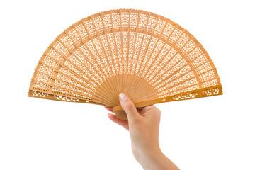 Wood fan in woman hand
