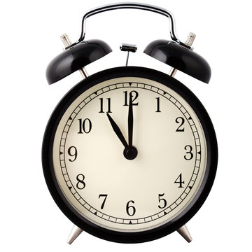 Old Alarm Clock in black and white, showing eleven o'clock.