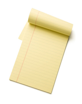 Yellow legal pad isolated on white background