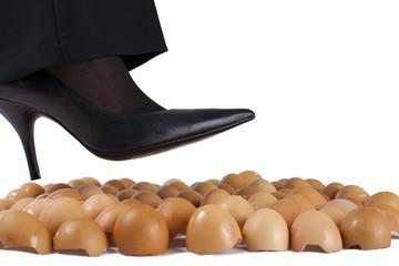 Woman walking on egg shells , white background.