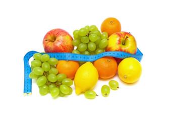 Still Life. fresh fruit and measuring tape.