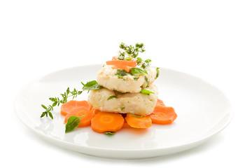 Merluzzo in umido su letto di carote - Isolated