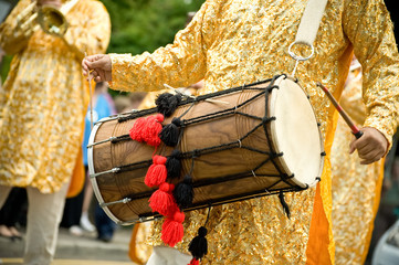 musician playing a tradition asian dhol drum