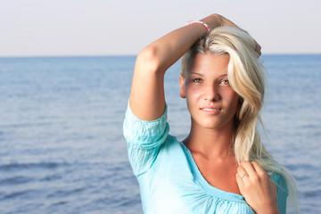 Beautiful blonde woman in bikini in the sea