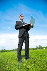 Stock Photo: young adult businessman working in country
