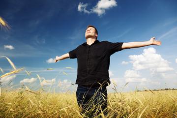 man rest on wheat field