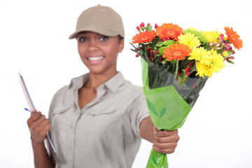 Delivery woman giving flowers