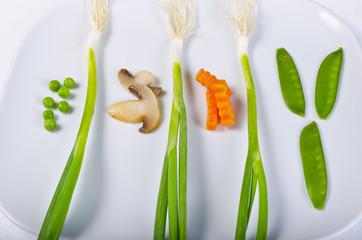 komposition mit  Lauch-Zwiebel, champignon ,  Erbsen