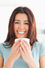 Portrait of a good looking woman enjoying a cup of coffee