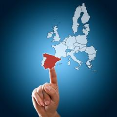 Finger wählt Spanien auf Touchscreen aus